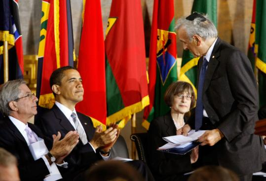 President Obama applauded Holocaust survivor Elie Wiesel during the Holocaust remembrance ceremony yesterday.