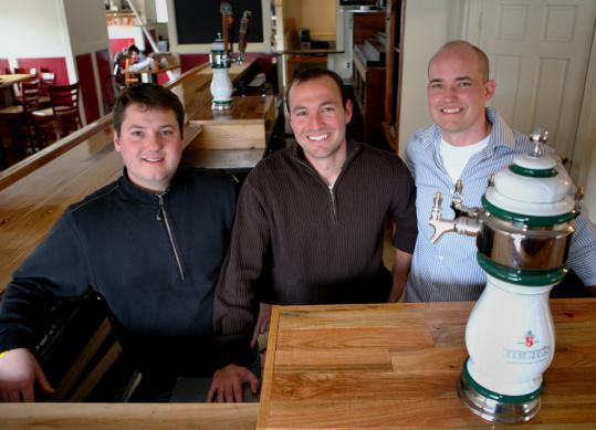 From left, Ryan Cox, Noah Goldstein, and Bradley Atkinson switched careers and opened The Farm Bar and Grille in Essex.