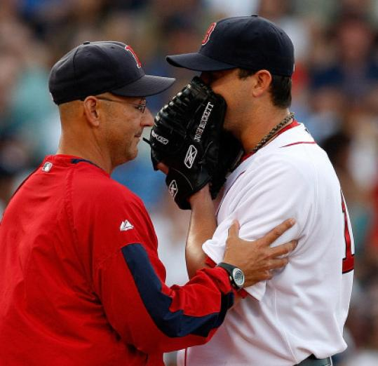 Manager Terry Francona takes Josh Beckett out in the sixth.