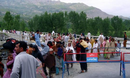 Residents fled an area of Pakistan's Lower Dir district, where troops battled militants yesterday.