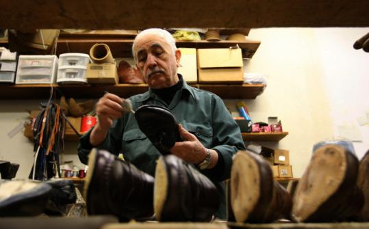 Hovsep Besnilian, owner of Concord Shoe Repair for three decades, has been replacing more soles on shoes recently.