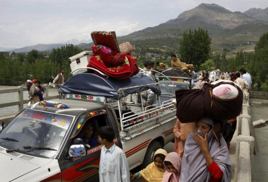 Residents fled the Lower Dir district yesterday in Pakistan, where security forces launched an operation against militants. Taliban militants called a peace deal ''worthless'' after officials sought to tighten their grip along the Afghan border.