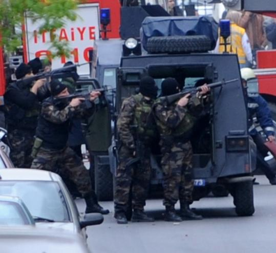 Turkish forces took position in Istanbul. An alleged militant wounded seven officers as they tried to raid his apartment.