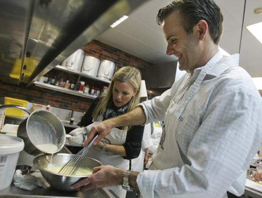 Mira and Jeff Woods work on a dessert recipe during a couples cooking class at the Cambridge School of Culinary Arts.