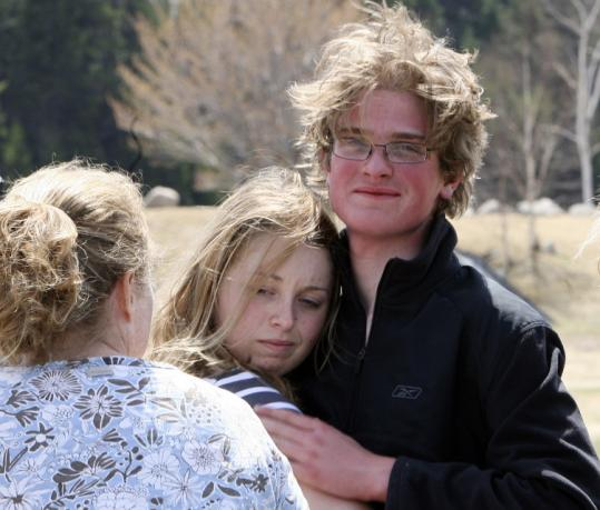 Scott Mason, 17, from Halifax, Mass., got a hug from his sister, Amy, yesterday after descending Mount Washington.