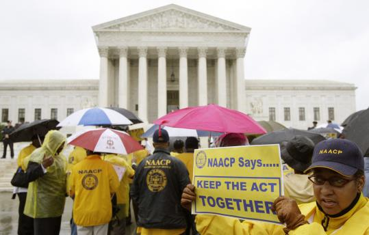 About 100 members of the NAACP demonstrated outside the Supreme Court yesterday against a challenge to the Voting Rights Act of 1965. The challenge was brought by a Texas district, which asked the court to strike down an extension of the law.