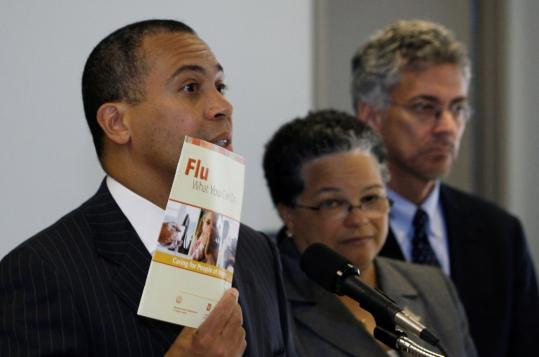 Governor Deval Patrick held up a pamphlet on how to treat the common flu as he spoke about swine flu concerns yesterday along with Dr. JudyAnn Bigby, state health and human services secretary, and John Auerbach, public health commissioner.