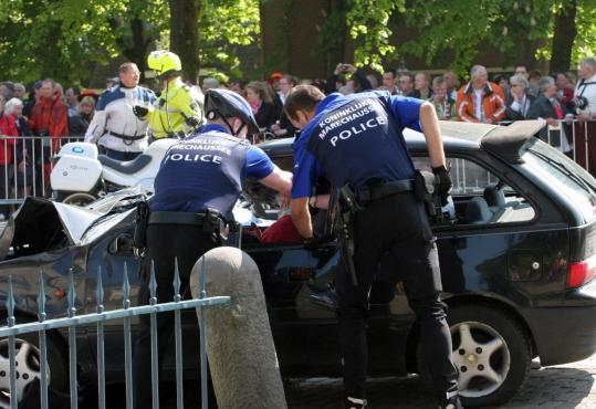 BERNHARD RUEBSAMEN/AFP/Getty Images)Police officers apprehended the driver of a car who had driven through a crowd in an apparent attempt to ram Queen Beatrix's motorcade during a parade in Appeldorn, the Netherlands.