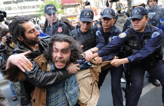 Riot police arrested a demonstrator during a May Day rally in Istanbul. The Turkish Parliament made May 1 a national holiday.