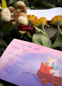 Flowers and notes were left at the crash site yesterday to honor the six victims.