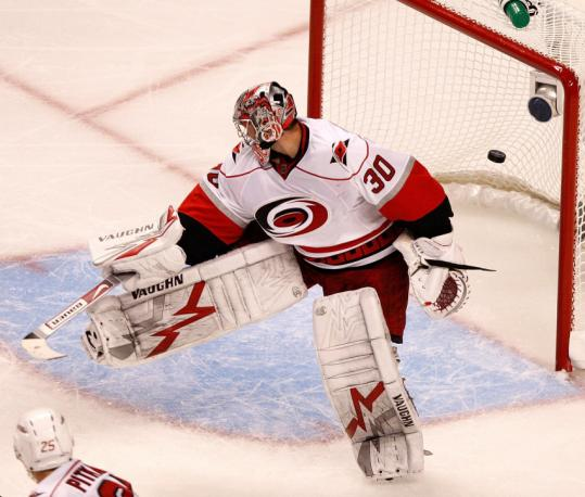 Carolina's Cam Ward could only look the part of a goalie as Marc Savard's second goal of the game made it 4-1 in the third period.