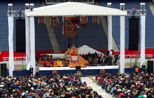 The Dalai Lama's address was about the path to peace and happiness. In the morning, he gave a lesson about the teachings of Buddha and The Four Noble Truths. The Patriots cap was a big hit.