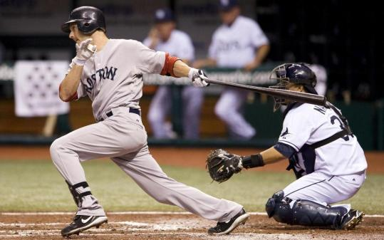Nick Green doubles in the second inning, driving home a pair of runs for the Red Sox.