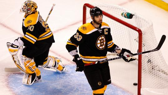 Tim Thomas (left) and Zdeno Chara can ignore the elephant in the room - or the puck in the net - but Carolina still scored first.