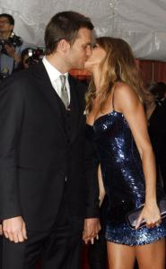 Tom Brady and Gisele Bundchen share a kiss at the Met last night.