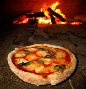 The Margherita Napoletana pizza is loaded with mozzarella, basil, and tomato sauce on a thin but still chewy crust.