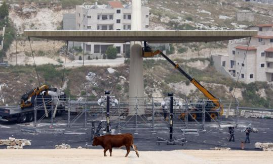 Workers prepared the site on Mount Precipice where Pope Benedict XVI will celebrate Mass at an amphitheater overlooking Nazareth. It is being expanded into a concert-sized facility.