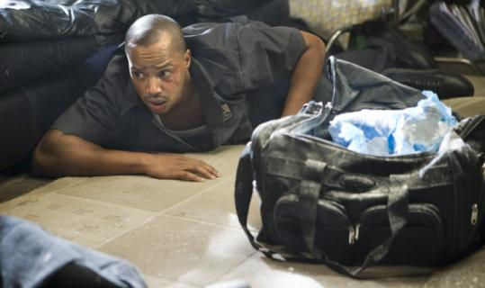 Donald Faison as a weed-smoking delivery man in the film.