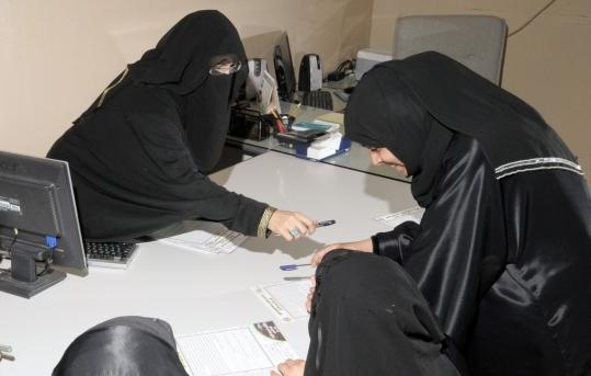 Khadra al-Mubarak (left) showing potential contestants brochures of the ''Miss Beautiful Morals'' contest. The pageant focuses on the contestant's commitment to Islamic morals.