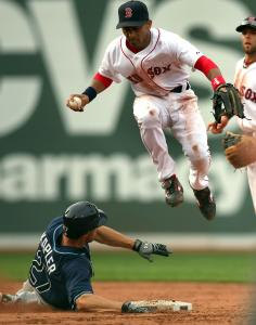 Sox shortstop Julio Lugo steps on second ahead of the slide of Gabe Kapler in the fifth inning.