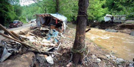 Flooding in Gilbert Creek, W.Va., damaged hundreds of structures, including mobile homes, and closed roads.