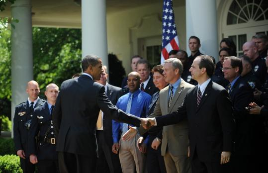 PAT ON THE BACK FOR POLICE - President Obama honored the winners of the National Association of Police Organizations' ''Top Cops'' awards yesterday at the White House. Obama said billions of dollars is being sent to states and cities to pay police salaries.