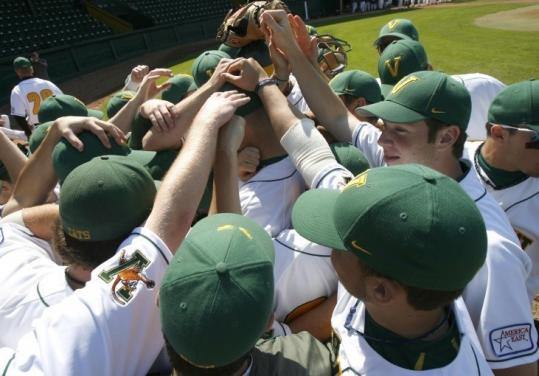Vermont players gather before the final home game at Centennial Field for a baseball program that dates to 1888.