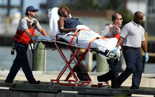 An unidentified survivor of a boat that sank off Florida was brought into Coast Guard Station Lake Worth yesterday.