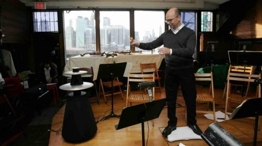 Paul Henry Smith uses a Wii controller as a baton to conduct his Fauxharmonic Orchestra.