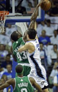 Kendrick Perkins, who had a strong paint presence, blocks J.J. Redick's shot.