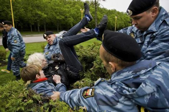 A Russian gay rights protester was taken away by riot police in Moscow yesterday. Police violently dispersed a gay pride demonstration banned by the authorities.