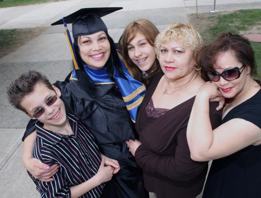 Essdras M Suarez/Globe StaffMigdalia Bachman graduated from Northern Essex Community College in Haverhill yesterday surrounded by her son, Christian; her daughter, Norma; her mother, Norberta Cerezo; and her sister, Marisol Mendez. She had received kidneys from her mother and brother.