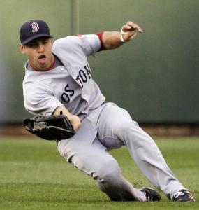Prolific base stealer Jacoby Ellsbury puts his sliding drills to good use in center field, taking a hit away from Ichiro Suzuki.
