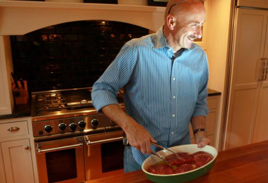 Bill Kinnealey's flat-iron steaks are ready for the indoor grill.