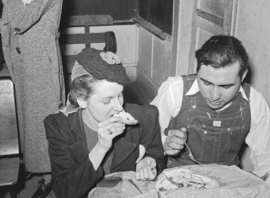Eating pie (probably made with a lard crust) sold at an auction in Muskogee County, Okla., are its baker (left) and the buyer.