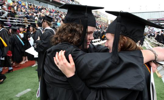 Meghan Butler, left, and Kristen Davitt embraced at the ceremony, at which Ken Burns spoke.