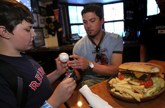 Brendan Burke, 13, of Barnet, Vt., (above) gets an autograph from Josh Beckett at McGreevy's, home of the Big Mouth Beckett Burger.