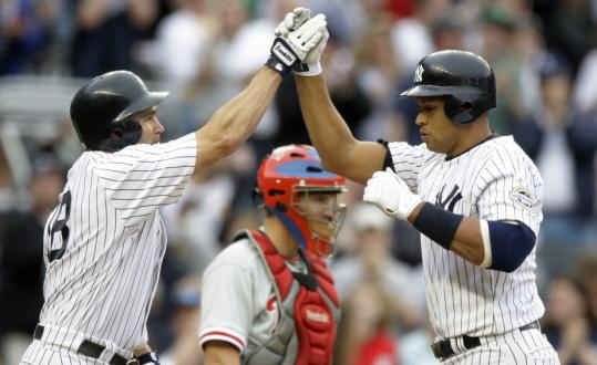 Johnny Damon has to hand it to Alex Rodriguez (right), who belted a two-run home run in the ninth inning to tie the game off Phillies closer Brad Lidge.