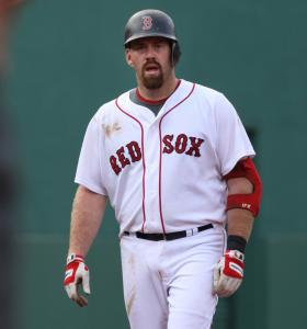Kevin Youkilis is incredulous after his fifth-inning shot over the Green Monster was ruled foul - twice. He later got some satisfaction when he cranked a three-run blast in the seventh.