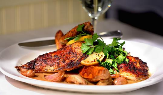 Roast chicken with garlic, lemon, and parsley at Hamersley's Bistro is a dish whose marinade and seasonings don't overpower, but rather showcase the bird.