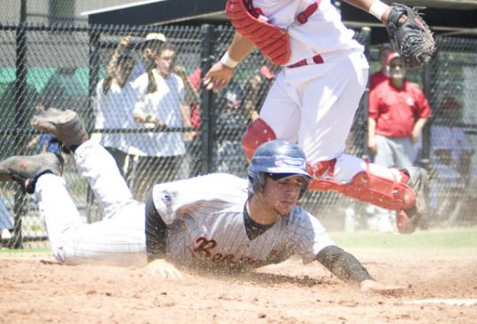 Brighton's Lorenzo Cruz reaches out and grabs a third-inning run with a slide around Madison Park catcher Jeffrey Santana.