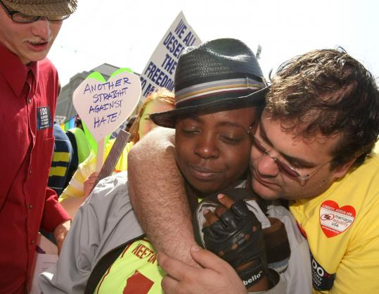 Alifah Ali was embraced by her friend Jay Matthew in San Francisco after the California Supreme Court upheld Proposition 8.