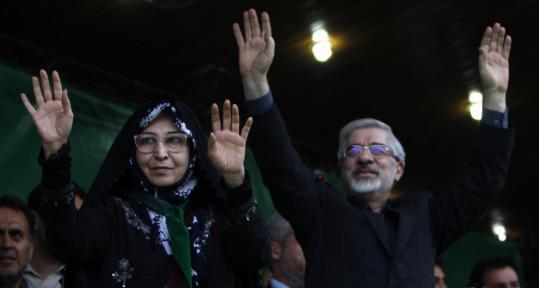 Iranian presidential candidate Mir Hossein Mousavi, with his wife, Zahra Rahnavard, during a rally in Tabriz. Rahnavard has become a key political asset, particularly among students.