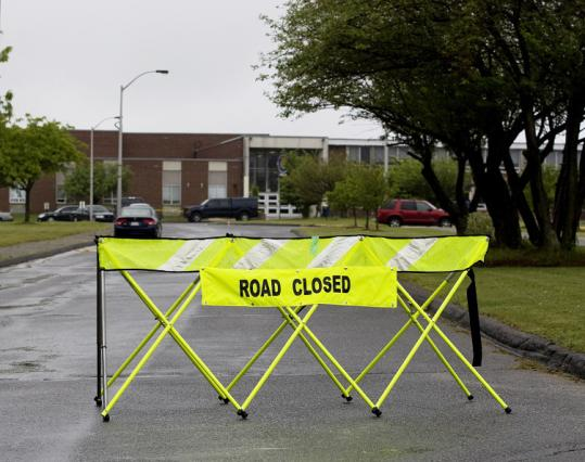 Police blocked the road leading to Stoneham High School yesterday after
