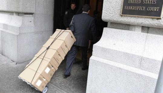 Boxes of documents related to Chrysler's month-old bankruptcy case were brought to court yesterday.
