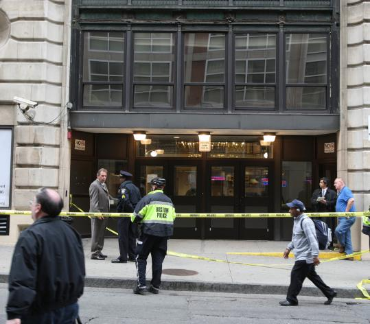 A Boston police officer who was working at St. Francis House at 39 Boylston St. in downtown Boston subdued a man who had stabbed another man at the homeless shelter, its director said.