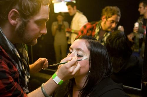 Primp before playing: 'Lover of air guitar for life' and two-time, undefeated Boston champion Erin McNally (aka McNallica) sat for makeup before the competition.