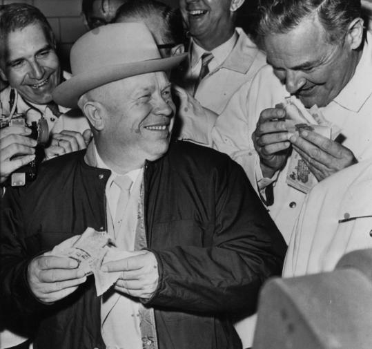 Soviet Premier Nikita Khrushchev samples a hot dog in Iowa while on his 1959 American tour.