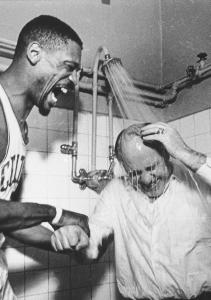 Red Auerbach got some help cooling down from Bill Russell after Boston won its seventh NBA championship.