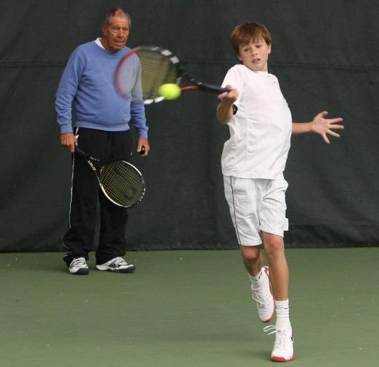 Christian Harrison, 14, under the watchful eye of tennis legend Nick Bollettieri, has already leaped to the pro ranks.